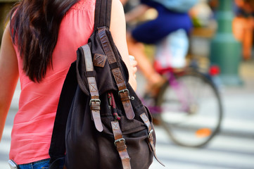 Woman with rucksack in the city