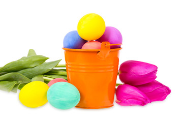 Bucket with Easter eggs and flowers