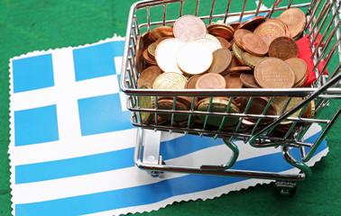 Shopping cart full of euro over Flag of Greece