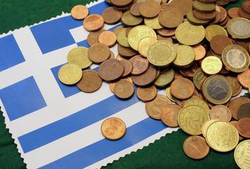 euro coins over Flag of Greece