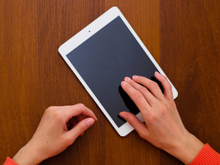Female hands holding generic tablet