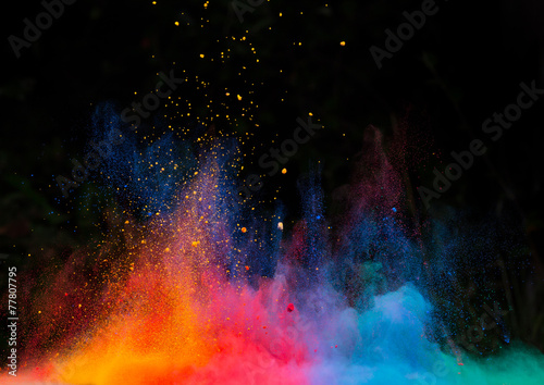 launched colorful powder over black - 77807795