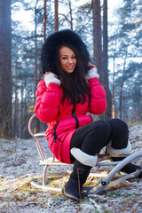 girl posing and sitting on the sledge