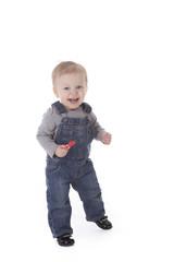 Baby girl in overalls