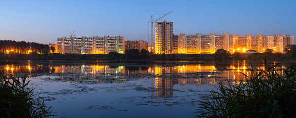 Construction of residential houses on the banks of the river in