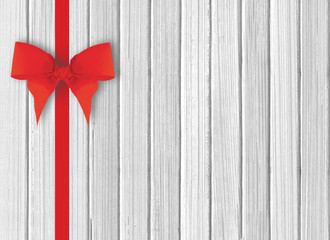 white wooden background with beautiful red bow