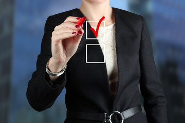 Businesswoman  making  a choice on  virtual Graph by a red pen