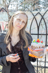 Woman holding a Easter cake