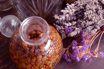 Bottle of raisins liqueur and lavender flowers