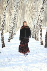 Russian beauty in the winter birch forest