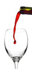 Pouring red wine into white glass the white background