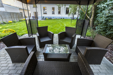 Wicker chairs on hotel's patio
