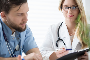 Two doctors consulting