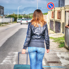 woman walking on the edge of the road