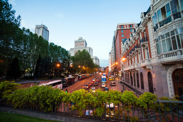 Night city view traffic with Edificio Espana on background in Ma