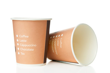 Paper disposable cups on white background. Back focus.