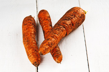 Freshly picked carrots on wooden background