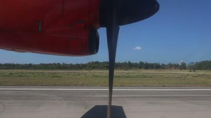 rotating aircraft engine propeller on runway
