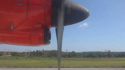 red aircraft speeding up greatly and takes off in blue sky