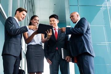 Asian business team presentation on tablet