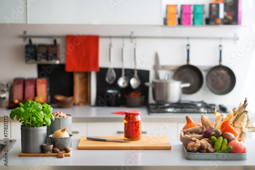 Closeup on table with vegetables in kitchen - 77821372