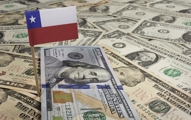 Flag of Chile sticking in various american banknotes.(series)