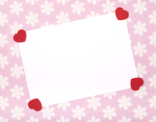 Blank celebrations card with red felt shaped hearts.