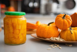 Closeup on jar of pickled pumpkin on table
