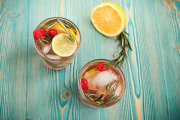 detox fruity water in two cups on blue wooden table