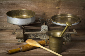 Mortar with kitchen tools on wooden background