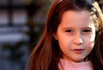 portrait of seven year old girl outdoors