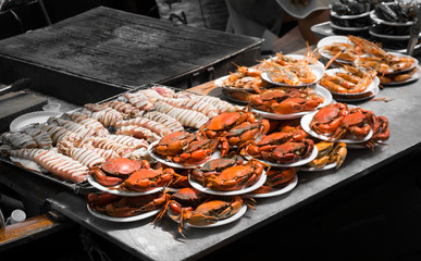 grilled seafood on floating market Ampawa, Thailand