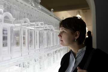 Woman looking at model building