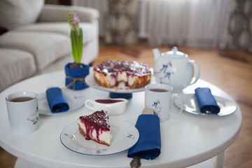 Cheesecake with berries, spring table setting