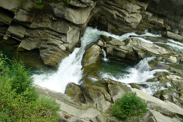 wild mountain river flowing over rocks