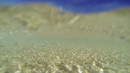 Turquoise sea underwater, view from sand. Puka beach, Boracay, P