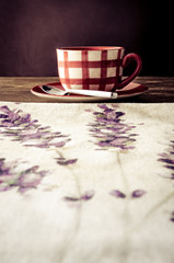 Vintage style coffee cup laid on wooden rustic table