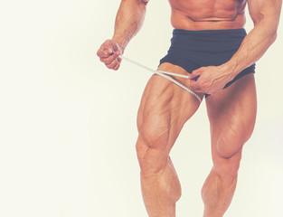 Close portrait of bodybuilder legs
