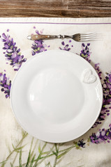 Fork and plate laid on vintage wooden dining table