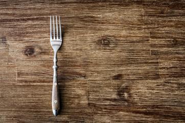 Dining fork on vintage wooden table