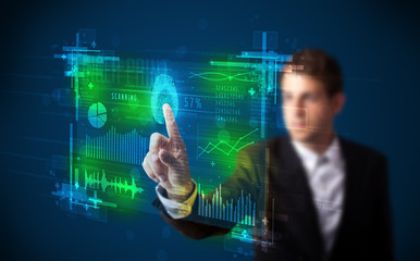 Young businessman pressing modern technology panel with finger p