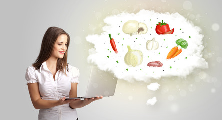 Pretty woman presenting a cloud of healthy nutritional vegetable