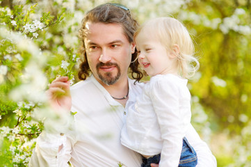 Father and toddler girl having fun at spring