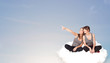 Young women sitting on cloud with copy space