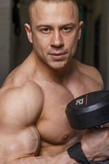 Strong muscular man bodybuilder