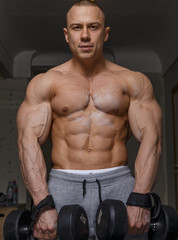 Strong muscular man bodybuilder