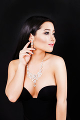 portrait of beautyful young asian woman. jewerly and diamonds