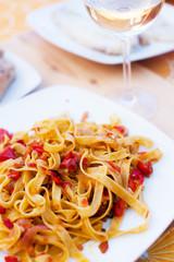 Tasty pasta and white wine