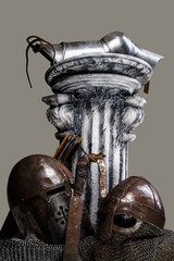 Antic column with sword and helmets