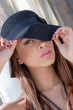 fashion woman with hat make up and flawless skin